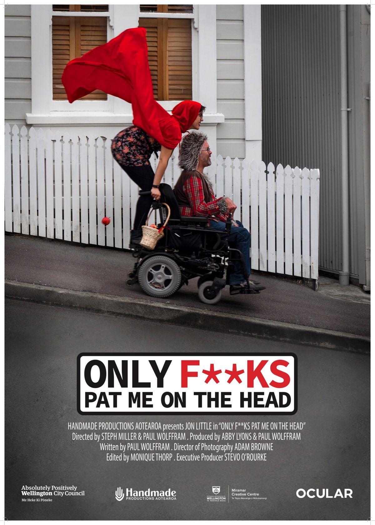 Movie poster showing a man and woman in fancy dress riding a wheelchair down a steep street.